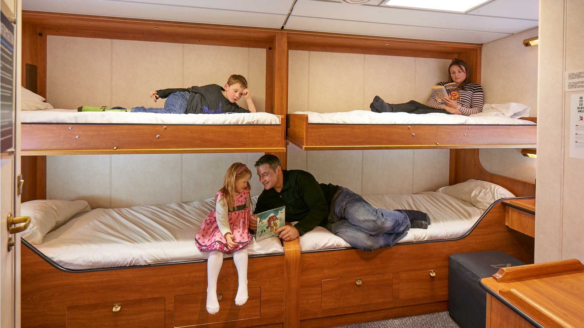 Family relax in Bluebridge Ferry private cabin